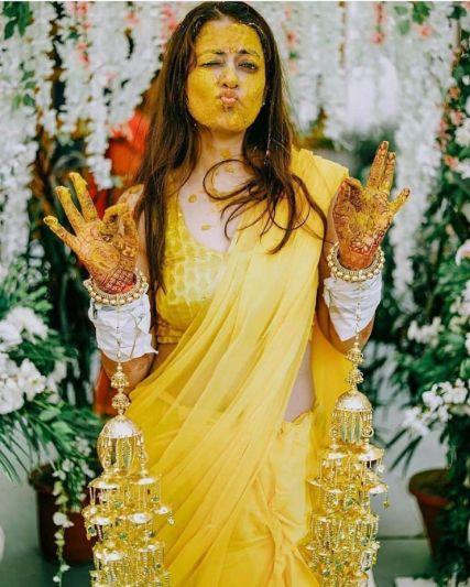 cute photo of a bride on her haldi ceremony | Wedding Trends for Haldi Ceremony