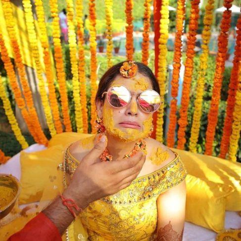 funny bride posing on her haldi day