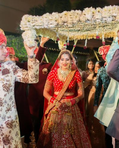 Sabyasachi Bride entering under phoolon ki chhadar
