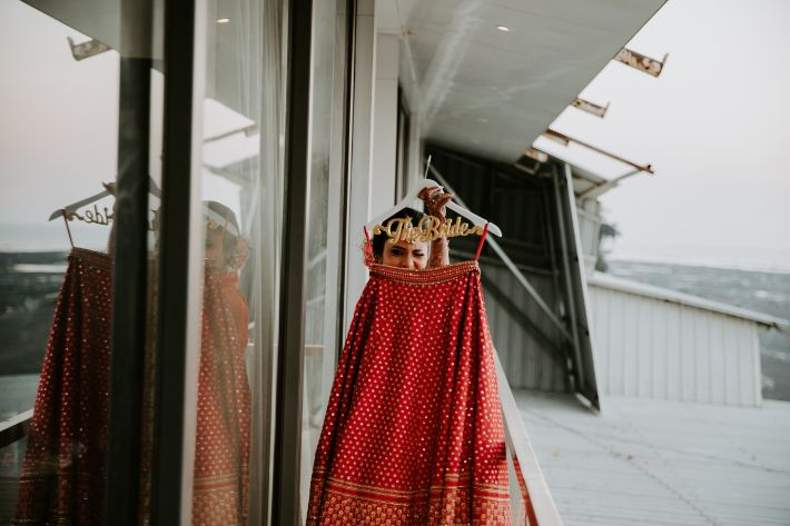 bride posing with her wedding outfit | destination wedding in Daman