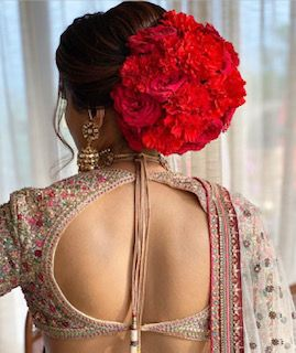 red bun hairstyle | dori style indian blouse design | anita dongre bridal lehenga styles | back blouse styles for indian brides of 2020 | #wittyvows #indianbrides #lehengastyle #bridallehnga #peachlehenga #whitelehenga #backlessblouse