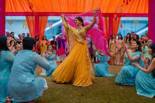 dancing indian bfride at her mehendi ceremony