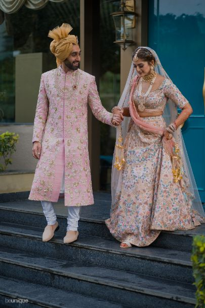 hand in hand, together till the end, bride and groom walking towards their big day   Jaipur Wedding