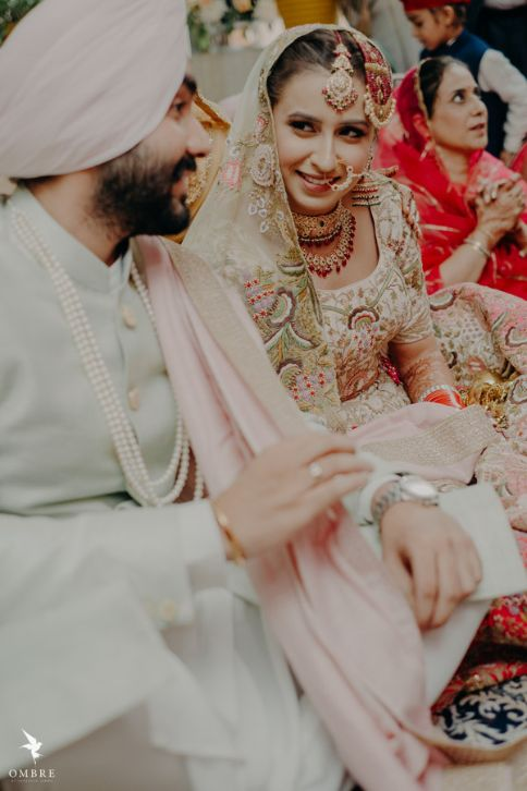 Sikh couple candid capture | Rimple & Harpreet Wedding Lehenga