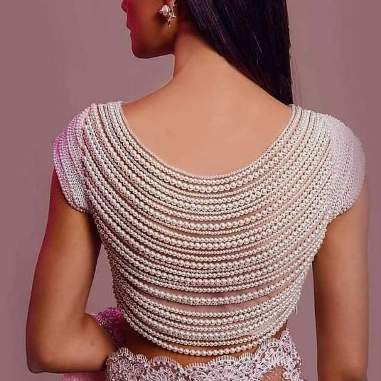 pearl detailing to blouse desgins | back blouse pearl bbackless design for indian weddings indian bridal lehega | indian style bllouse designs for 2020 indian brides | indian style back blouse designs | #weddings #wittyvows #lehenga