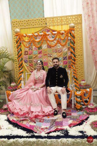 couple photo shoot at mehendi | Modern Customised Lehenga Embroidery