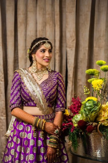 indian bride in purple lehenag