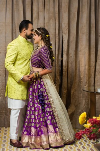 indian couple photography ideas | groom in perfect neon green sherwani