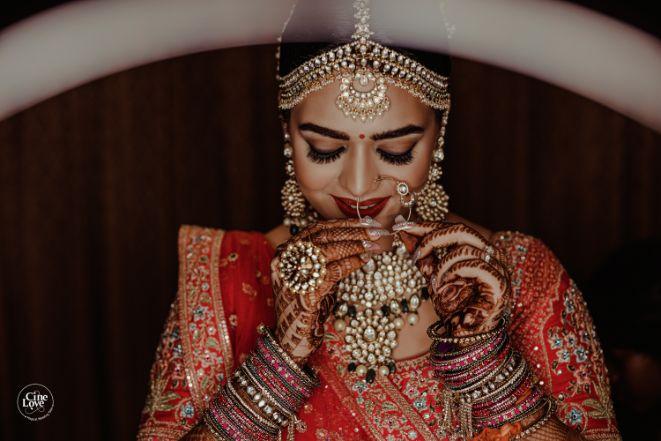indian bridal poses | Gorgeous Sabyasachi Lehenga in Pink - Delhi Wedding | Gorgeous Sabyasachi Lehenga in Pink - Delhi Wedding