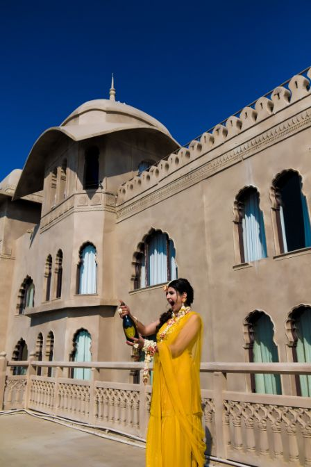 bride in stunning yellow outfit for her haldi day