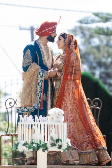 stunning indian couple   blue outfit for the groom   Cutest Surprise Proposal Ideas