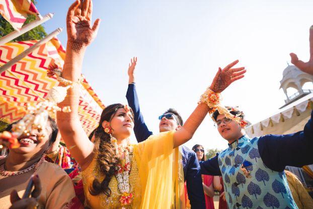 dancing bride on haldi day