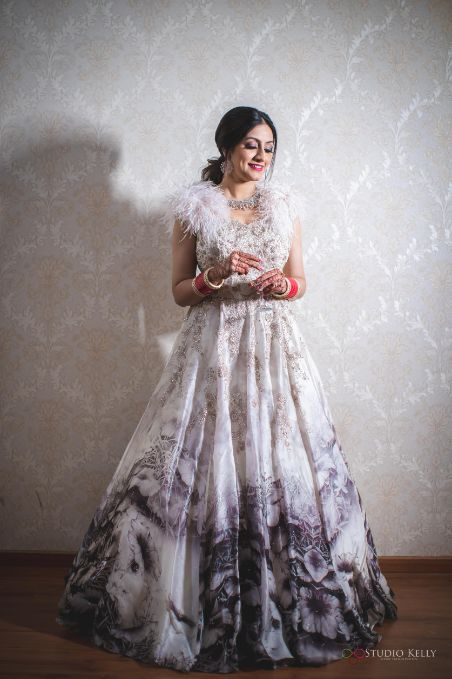 indian bride in white gown for reception day | Stunning Reception Look