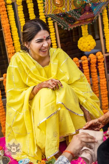 brides yellow outfit for haldi day | Mirror Work Lehenga for Mehendi