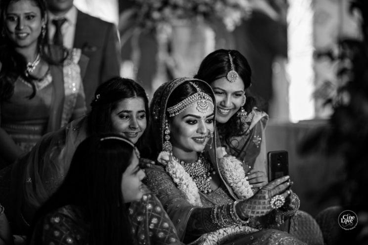 photo with the bridesmaids | Gorgeous Sabyasachi Lehenga in Pink - Delhi Wedding