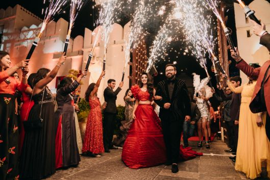 bride in beautiful red lehenga with modern blouse | coouple entry ideas