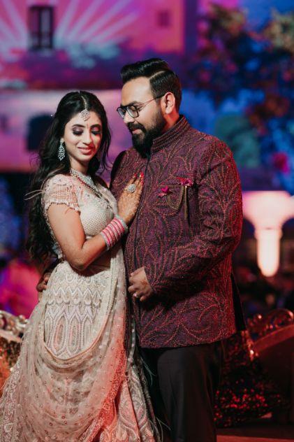 bride and groom posing for photos | Destination Wedding in Udaipur