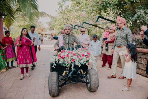 groom entry on an ATV| Stunning Colourful Wedding Lehenga