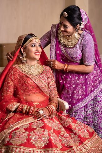 indian bride in red lehenga | mother of the brid ein unique purple lehenga