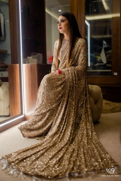 indian bride in stunning goldeb sabyasachi saree | Sabyasachi Saree in Gold Sequins