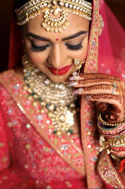 indian bride posing for photos | Gorgeous Sabyasachi Lehenga in Pink - Delhi Wedding