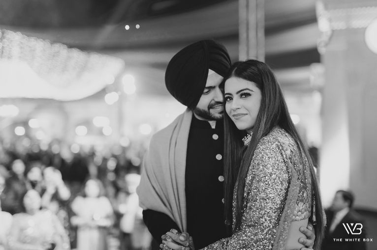 stunning sikh couple at their reception | Sabyasachi Saree in Gold Sequins