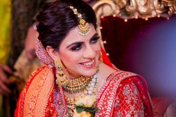 candid bridal photo | bridal makeup gaols | Anita Dongre Wedding Lehenga