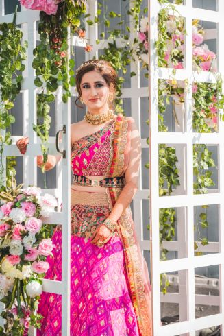 stunning pink bridal outfit for mehendi ceremony   Printed Lehenga  & a Gorgeous Off Shoulder Blouse - Megnha & Devansh