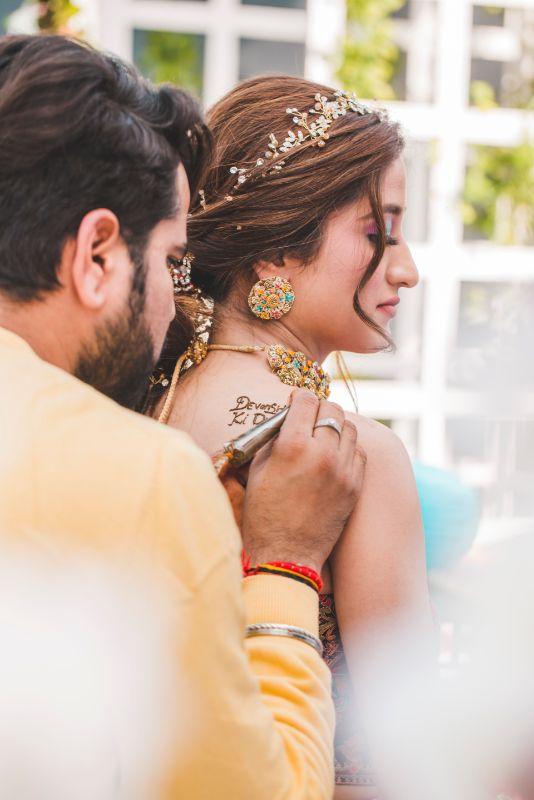henna tattoo on shoulder | mehendi ceremony | Printed Lehenga  & a Gorgeous Off Shoulder Blouse - Megnha & Devansh