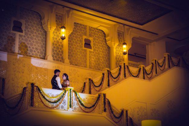 bride and groom photo shoot on sangeet day   Printed Lehenga  & a Gorgeous Off Shoulder Blouse - Megnha & Devansh