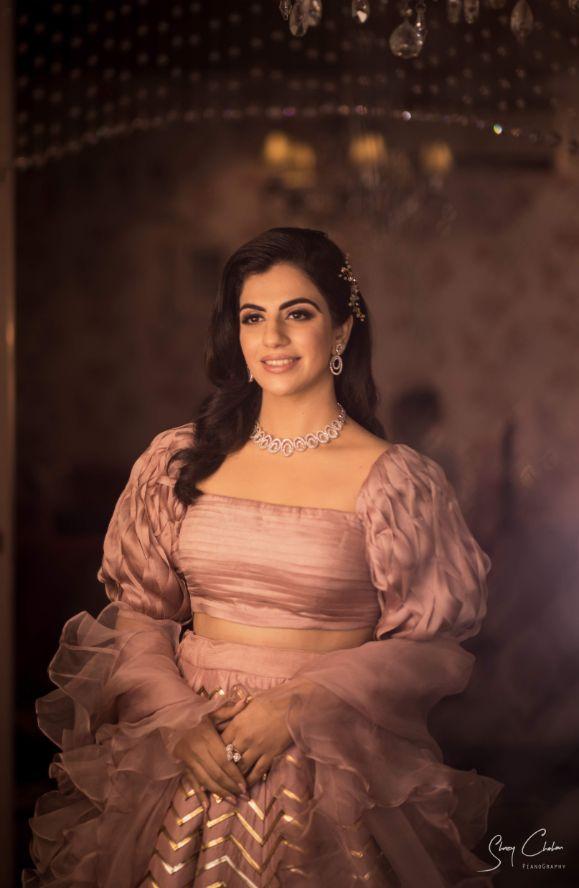 stunning bride in beautiful pink lehenga