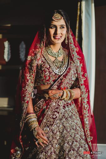stunning red bridal lehenga with heavy embroidery work