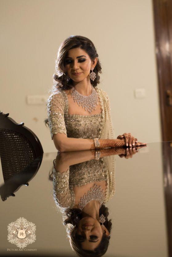 indian bridal photo shoot ideas | Mirror Work Lehenga for Mehendi