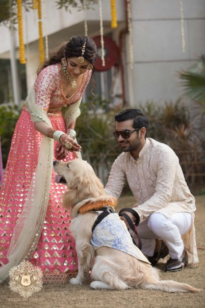 indian bride and groom with their pet dog | Mirror Work Lehenga for Mehendi