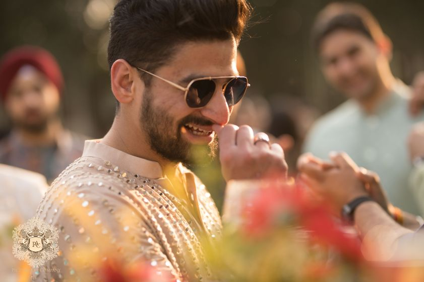 groom in sunglasses at mehendi ceremony   Mirror Work Lehenga for Mehendi