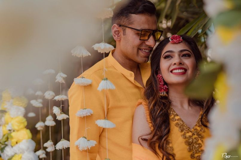 yellow outfit for the bride and grooms haldi ceremony