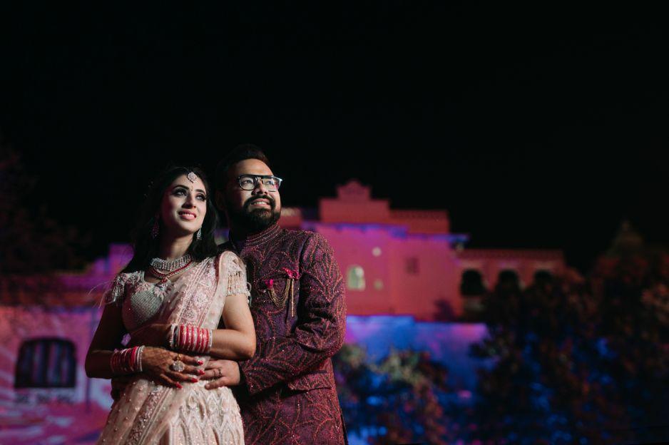 couple posing for photos | Destination Wedding in Udaipur