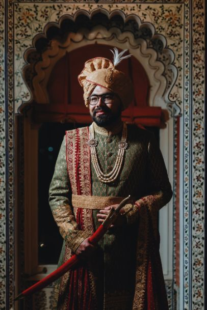 indian groom in pastel green sherwani |Destination Wedding in Udaipur