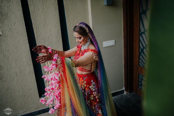 bride wearing floral kaleere | Stunning Colourful Wedding Lehenga - Beautiful Goa Wedding