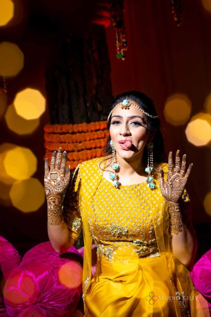 bridal mehendi photos | yellow outfit for the bride