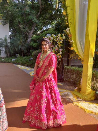 bride in beautiful pink lehenga