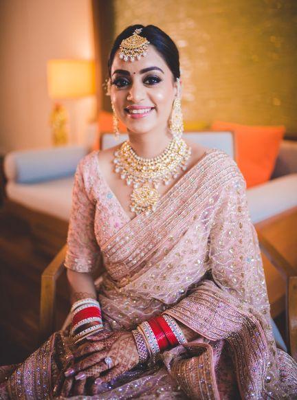 indian bride | pastel pink lehenga | red chooda for the bride | Beach Wedding in Hua Hin