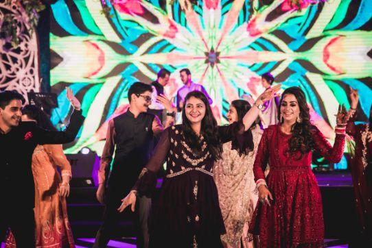 relatives dancing at indian weddings | Beach Wedding in Hua Hin