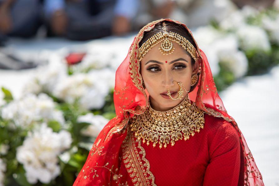 indian bridal portrait | red chooda bridal wear accessories | Destination wedding in Italy & Red Sabyasachi lehenga sikh wedding nri indian weddings #wittyvows #indianbride