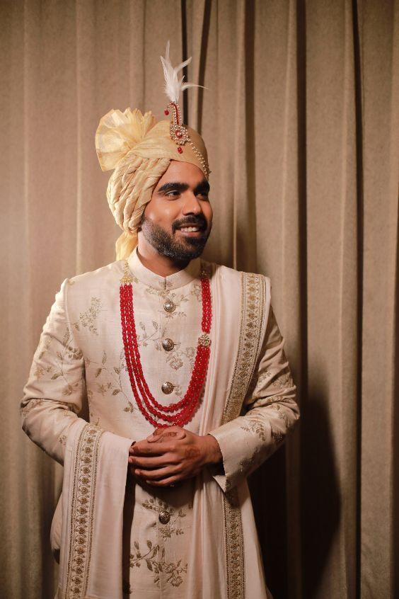 groom sabyasachi groom | funny couple moments green sabyasachi lehenga | indian bride groom | wittyvows | bridal lehenga | floral wedding | chomu palace