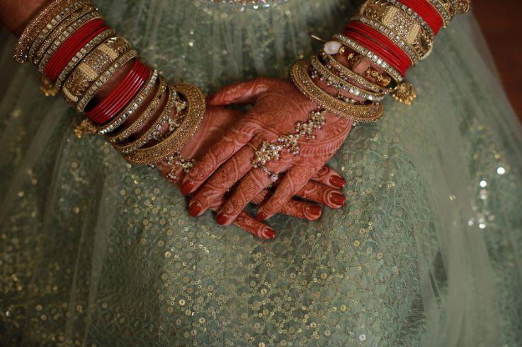 chooda design | funny couple moments green sabyasachi lehenga | indian bride groom | wittyvows | bridal lehenga | floral wedding | chomu palace