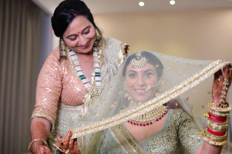 mother daughter moment   green pastel wedding   pastel lehenga   funny couple moments green sabyasachi lehenga   indian bride groom   wittyvows   bridal lehenga   floral wedding   chomu palace