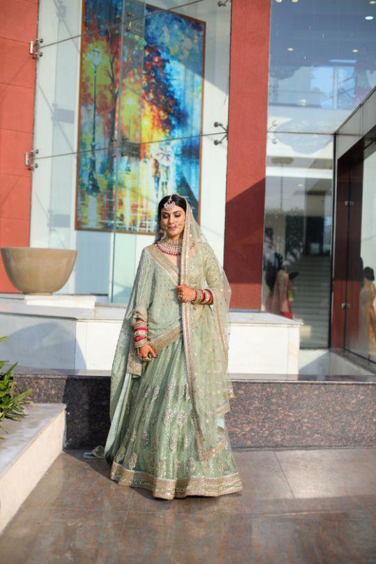green pastel lehenga   close of indian bride   indian bridal jewllerey   wittyvows   chooda designs   nude makeup look destination wedding