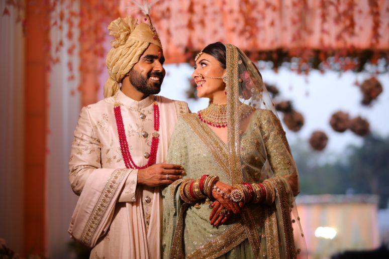 green sabyasachi lehenga   indian bride groom   wittyvows   bridal lehenga   floral wedding   chomu palace