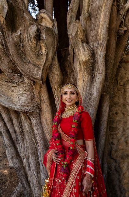 vermala twirling sabyasachi bride | indian couple photoshoot | indian bridal portrait | red chooda bridal wear accessories | Destination wedding in Italy & Red Sabyasachi lehenga sikh wedding nri indian weddings #wittyvows #indianbride